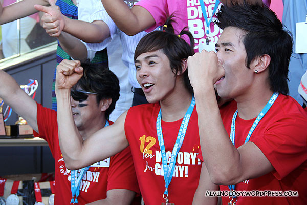 The guy with the ribbons on his hair is called Alexander, of Korean boy band, U-Kiss fame