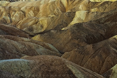 Layered Earth - Zabriskie Point, Death Valley National Park, California (Jim Patterson Photography) Tags: california longexposure morning travel usa abstract color nature yellow sunrise landscape photography gold dawn golden nationalpark bravo patterns tripod landmark icon erosion filter layer deathvalley zabriskiepoint iconic gitzo daybreak compressed reallyrightstuff nikkor3570mm singhray goldnbluepolarizer nikond300 markinsm20ballhead jimpattersonphotography jimpattersonphotographycom seatosummitworkshops seatosummitworkshopscom