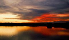 split personality (bdaryle) Tags: light sunset sky lake nature water clouds reflections sony silhouettes splitpersonality justclouds mywinners 100commentgroup brandondaryle bdaryle imagesbybrandon