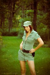 A real green dress #2 (Mike Wood Photography) Tags: trees portrait woman sexy green beautiful face look hat leather standing army outdoors eos belt intense jen dress jennifer gorgeous military branches lips cover portraiture short arr grasses features tall zip allrightsreserved zippered mikewood 450d mikewoodphotographycom mikewoodphotography