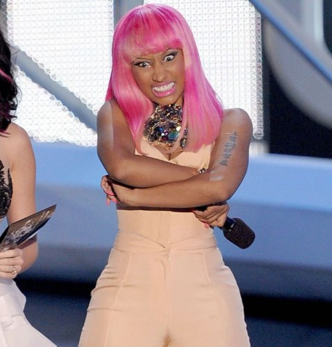 LOS ANGELES, CA - SEPTEMBER 12:  Singers Katy Perry (L) and Nicki Minaj speak onstage during the 2010 MTV Video Music Awards at NOKIA Theatre L.A. LIVE on September 12, 2010 in Los Angeles, California.  (Photo by Kevin Winter/Getty Images) *** Local Capti