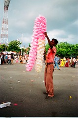 Candy man (Lazybug) Tags: india analog hyderabad hawker nikonfm3a ganeshvisarjan sugarcandy sigma24mmf28 lazybug hyderabadphotographyclub akhiltandulwadikar fujifilmcrystal200