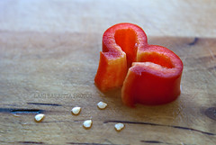 fun with lunch (Lani Barbitta) Tags: red love heart 50mm18 redbellpepper nikond80 onthecuttingboard lanibarbitta bellpepperseedlings