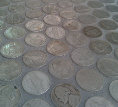 Bathroom floor tiled in nickels closeup