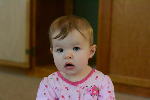 Ella sitting by the cabinet - Nikon D3100 @ ISO 6400