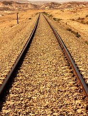 Desert Railroad (Phish Photography) Tags: railroad mountain mountains nature canon landscape geotagged israel raw desert gimp explore journey rails zion negev thegimp scenics digitalphotography mountainrange ufraw sigma2470mmf28exdgmacro explored extremeterrain makhteshramon canoneos450d canoneoskissx2 canondigitalrebelxsi phishphotography