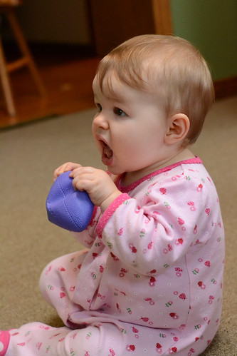 Ella crushing football - Nikon D3100 - ISO 3200 - flash