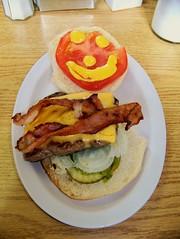 Smiley-face banquet burger (Will S.) Tags: mypics kaladarrestaurant kaladar ontario canada banquetburger smileyface bacon cheese beef mustard relish onions happyham