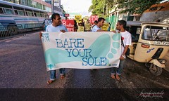 BARE YOUR SOLE WALK (The Psychedelic Illusionist) Tags: poverty people canon foot movement community place stitch walk protest peaceful sri lanka horton barefoot housing habitatforhumanity srilanka dailylife volunteer sole protests slum homelessness hfhsl hortonplace homelesness canoneos5dmkii ourworldsociety