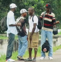 Street Smarts (Legin_2009) Tags: road street man black male men guy corner bag outside outdoors happy joke caps hats guys sidewalk jeans shirts cap laugh males caribbean shorts jerseys streetcorner polo mec mecs cargobakcpackshaversacksgroupshorts