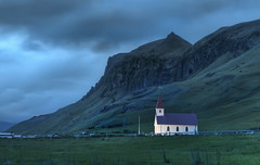 A Lonely Night in Iceland (Stuck in Customs) Tags: world travel wild mountain cold church night clouds digital island photography volcano iceland blog high europe cross dynamic stuck dusk rocky overcast glacier photoblog caldera software processing lone imaging lonely geology wilderness solitary volcanic range hdr eruption tutorial trey sland travelblog customs icelandic e15 geological northatlantic icecap skogar eyjafjallajkull midatlanticridge ratcliff eyjafjll hdrtutorial stuckincustoms treyratcliff photographyblog eyjafallajokull stuckincustomscom