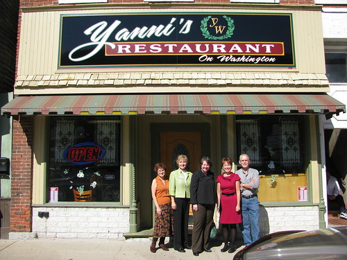 Deputy Secretary Kathleen Merrigan stopped at Yannis Restaurant on her tour of businesses that benefitted from a revolving loan program funded by a USDA grant to renovate their historic buildings. From left, Main Street Momence board member Fran LeBeau, USDA Rural Development State Director Colleen Callahan, Merrigan, Main Street Momence Executive Director Janine Loftus, and building owner John Valaveris.