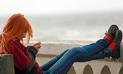 Peaceful Communion (Ian Sane) Tags: red beach girl sign oregon hair ian photography seaside shoes phone candid text cell peaceful conversation piece communion turnaround messaging sane