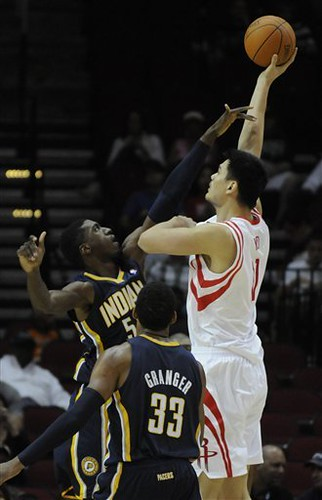 October 9th, 2010 - Yao Ming shoots over Indiana Pacer Roy Hibbert.  Yao scored 10 points in 12 minutes of action