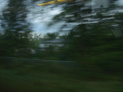 The scenery rushing by the train window.