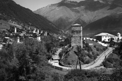Svanetian Tower (Mestia, Georgia) (bm^) Tags: travel bw panorama white black mountains tower georgia blackwhite nikon zwartwit toren reis caucasus bergen zwart wit clairobscure sakartvelo reizen svan d90 georgi  svaneti mestia   svanetia nikond90 southerncaucasus  svantower svanetiantower svaneti