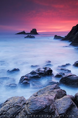 Afterburner - Laguna Beach, California (Jim Patterson Photography) Tags: ocean california longexposure travel pink light sunset red sky seascape nature vertical clouds landscape coast rocks shadows purple pacific tripod shoreline shore lagunabeach losangelescounty jimpattersonphotographycom seatosummitworkshops seatosummitworkshopscom