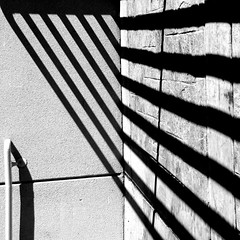 I Whip My Hair (Lord Jezzer) Tags: shadow bw lines shadows stripes explore repetition railing
