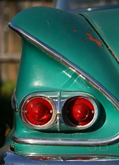 green Biscayne taillight (Studiobaker) Tags: studiobaker iowa ia northeastern ne october 2010 fall autumn oct florenceville chevy chevrolet biscayne green teal rear chrome silver fade faded trim taillight red lamp curve curves curvy glow gleam bright sun sunny bumper trunk fender flare pair duo