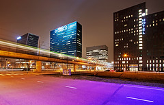 Randstadrail - The Hague (DolliaSH) Tags: city longexposure people urban streets holland color colors architecture night train canon photography photo topf50 streetlight europe cityscape foto nightshot photos nederland thenetherlands rail railway denhaag le topf100 thehague 1022 afterdark zuidholland canonefs1022mmf3545usm randstadrail nhhotel nachtopname canoneos50d tntpost schenkkade dollia dollias sheombar dolliash