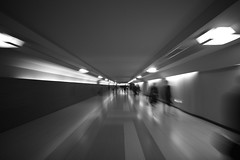 Tunnels of Tokyo Station (MiAnder Images) Tags: street city longexposure urban blackandwhite bw blur monochrome station japan architecture night speed underground subway tokyo blackwhite movement interior symmetry commute   parallel 1022mm 2011