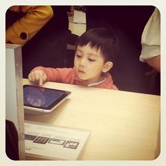 I 3> iPad (Reelene) Tags: boy square child beijing applestore squareformat ipad earlybird iphoneography instagramapp uploaded:by=instagram