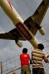 ...... (Shad0w_0f_Dark) Tags: sky boys canon airplane fly bars emirates 7d photowalk barrier ttl dhaka tamron runway 2010 flyingplane uttora bawnia wmirattokina