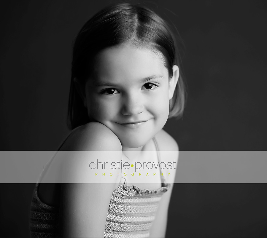 black and white portrait of little girl in studio lighting