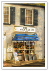 The Cottage Bakery, Lyme Regis (Manin The Moon) Tags: windows england food signs building cute english history cake shop bread store pretty britain cottage romance bakery shutters british quaint lymeregis tempting vanagram