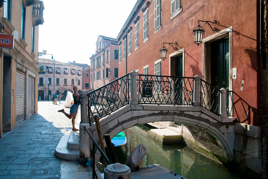Girl posing on a bridge over a canal in Venice, Italy
