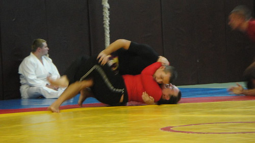 Woman (me) grappling no-gi BJJ