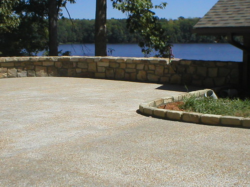 view of Lake Gaston from driveway surrounded by short curved stone Wall on this home near Wise, North Carolina
