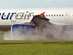 Onur Air A321 reverse-thrust (Irish251) Tags: ireland dublin water airport air 321 spray reverse dub onur thrust eidw tconj