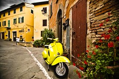 Lari, Toscany. Vespa parked in front of a house (Nicola Zingarelli) Tags: old flowers italy colors yellow town cool italian vespa symbol lifestyle style scooter everyday typical moped brand lari fashionable toscany italianstyle colorphotoaward typicallyitalian