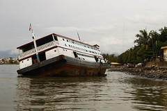 Our Ferry Sank (joeyL.com) Tags: lighting tattoo ferry trekking indonesia boat rainforest photoshoot battery uma culture photographers tourists generator western hunter guide explorers healing behindthescenes ricky travelers translator shamanism solarpower sacrafice gatherer joeylawrence profoto elinchrom joeyl mentawai siberut caleglendening gejeng willemisbrucker