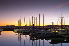 Boats in Dock (Isaac PDX) Tags: longexposure pink sunset orange sun moon lake water colors oregon sailboat nikon rocks purple fernridge d700 isaacviel