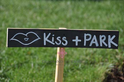 Kiss and Park sign at Wedding