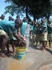 Ebumamu Primary School rehabilitated well-clean water flowing out.