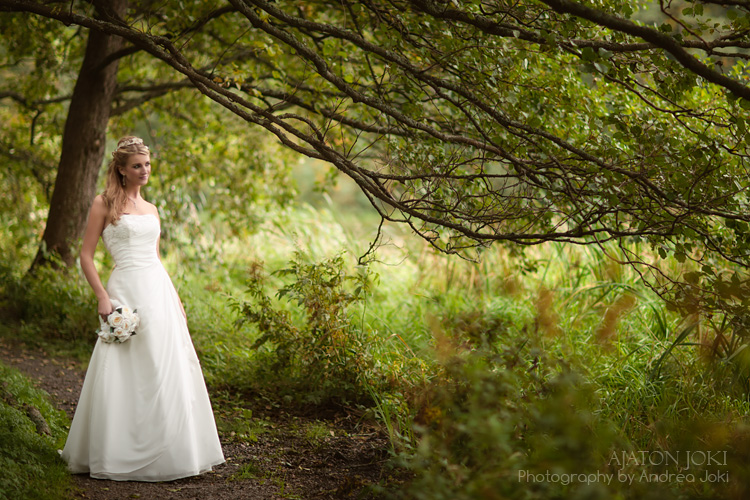 Finnish bride framed by tree branches