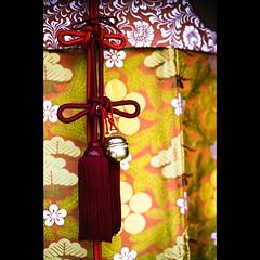 knots (Masahiro Makino) Tags: japan photoshop 50mm nikon kyoto shrine pattern bell f14 silk tie knot adobe  string  f3 nikkor dnp  lightroom kitanotenmangu centuria400 20090925nfcenturia4001ls640p
