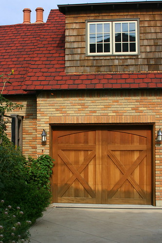 beautifully detailed driveway and garage doors