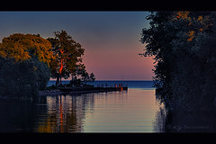 The Twilight Zone (KY-Photography) Tags: ca blue trees light sunset shadow red sky orange sun lake ontario canada nature water silhouette yellow night clouds dark landscape evening twilight nikon dusk ky guelph lakeshore nikkor mississauga khalid allrightsreserved kal gloaming d300 capturenx 70300mmf4556gvr nikond300 kyphotography khalidyousifie