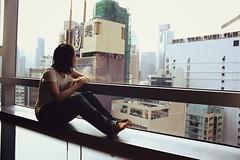 an awkward one; (foldedmemos) Tags: travel portrait hk holiday selfportrait reflection building window self canon concrete hongkong rebel hotel sitting room jungle ledge selfie lookingout 500d rebelt1i t1i compositionsucksbutthenwhocares