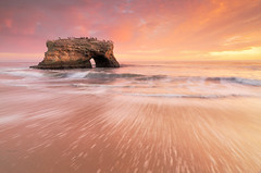 Archangel (EXPLORE #1 :) (Joshua Cripps) Tags: ocean california park santa pink light sunset sea orange seascape beach water beautiful landscape photography photo amazing sand long exposure waves glow purple natural state pacific streak joshua crash bridges wave cruz foam cripps