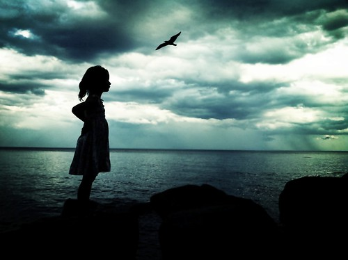 distant storms, a bird, and a little girl