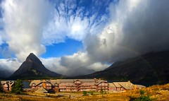 Here, Under the Rainbow (Deby Dixon) Tags: morning panorama storm tourism nature clouds landscape photography nationalpark rainbow travels nikon all hill scenic dixon lodge glacier rights glaciernationalpark drama reserved deby 2010 swiftcurrentlake manyglacier manyglacierlodge grinnellmountain