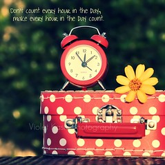 Don't count every hour in the day, make every hour in the day count. (Violet Kashi) Tags: light red stilllife flower alarm clock yellow time bokeh case polka dots cliche hcs