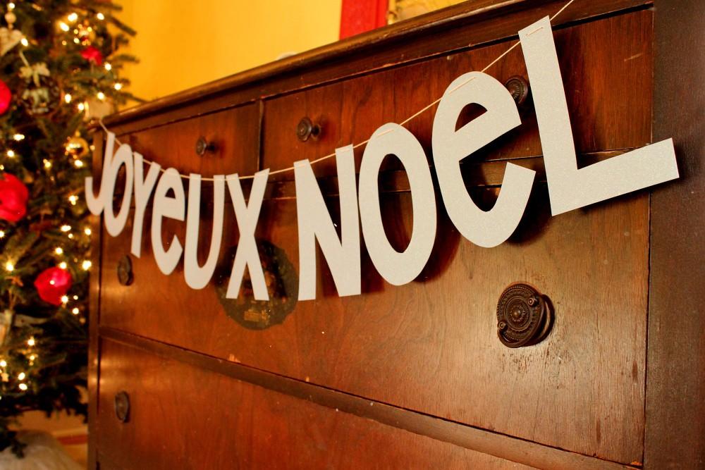 joyeux noel in glittery palest blue