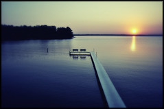 "_pl4to doesn't live h3re anymore, but th4nks..."" (dtomaloff) Tags: blue trees sunset lake nature water wisconsin outdoors pier spring nikon couple peace chairs yes horizon tranquility dt northwoods 2010 d90 minocqua davidtomaloff"
