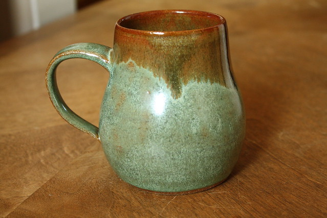 green & brown pear-shaped mug
